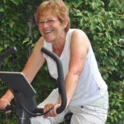 Senior woman on excersize bike